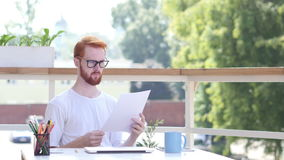 Paperwork, Reading, Designer Sitting in Balcony of Office Outdoor stock footage