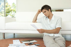 With Paperwork Sitting on Floor Stock Photo