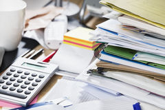 Paperwork: stack of files on messy desk Royalty Free Stock Photo