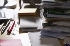 Paperwork: stack of files on messy desk Stock Photo