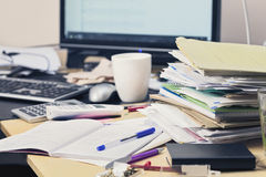 Paperwork: stack of files on messy desk Royalty Free Stock Photography