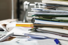 Paperwork: stack of files on messy desk Royalty Free Stock Images