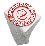Paperwork Stack Pile Papers Files Fill Out Busy Work. Paperwork word in 3d red letters on a stack of papers you must fill out in busy work and file your project Royalty Free Stock Photo