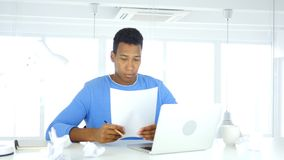 Paperwork, Writing and Working on Laptop stock photography