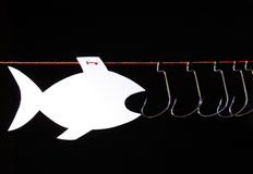 Papery fish and fish-hooks Stock Photo