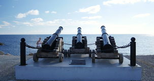 Paphos cannons admired by tourist stock video