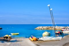 Banana boat, inflatable rings and boats for rent, Paphos. Paphos, Cyprus - July 12, 2017: Banana boat, inflatable rings and boats for rent, Paphos Stock Photography