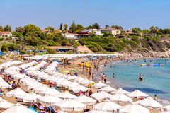 PAPHOS, CYPRUS - JULY 24, 2016: Coral Bay Beach, one of the best sandy beaches located near Pegeia village Stock Photos