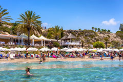 PAPHOS, CYPRUS - JULY 24, 2016: People relaxing on Coral Bay Beach, one of the most famous beaches in Cyprus Royalty Free Stock Photos