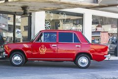 Red car Zhiguli with symbol Hammer and Sickle. Paphos, Cyprus - 18 September 2016: Red car Zhiguli with symbol Hammer and Sickle and inscription `USSR` side view royalty free stock photo