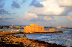 Paphos fort in evening. Paphos castle  in sunset  - Cyprus Stock Image