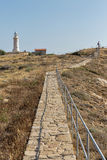 Paphos landscape with old lighthouse and woman on Cyprus Stock Image