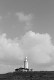 Paphos Lighthouse. View of  lighthouse from the archeological site of Paphos.The lighthouse on the hill, black and white, harbour Royalty Free Stock Image