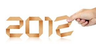 Papier 2012 humain d'Origami d'an de remplissage de main Image libre de droits