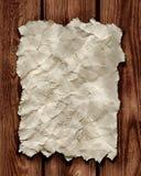 Papier auf hölzerner Wand Lizenzfreies Stockfoto