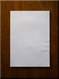 Papier blanc sur le bois Photos libres de droits