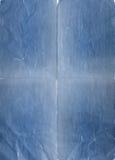 Papier bleu déchiré photographie stock