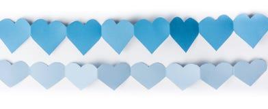 Papier bleu de coeur Photo stock