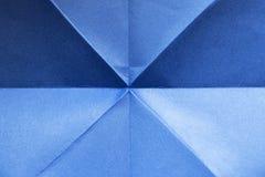 Papier bleu plié photos libres de droits