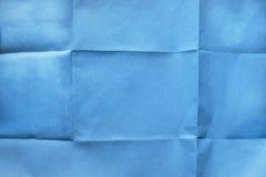 Papier bleu plié photographie stock libre de droits