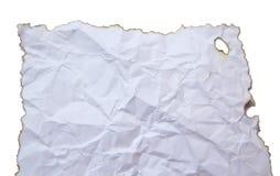 Papier brûlé d'isolement sur le fond blanc Images stock