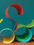 Papier coloré d'abstrait sur le fond bleu Photographie stock