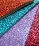 Papier coloré lumineux de scintillement empilé Image libre de droits