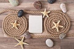 Papier, corde, étoile de mer, pierres de mer Image stock