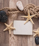 Papier, corde, étoile de mer, pierres de mer Image libre de droits