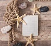 Papier, corde, étoile de mer, pierres de mer Photographie stock