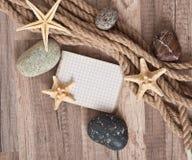 Papier, corde, étoile de mer, pierres de mer Images libres de droits