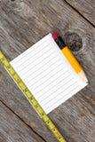 Papier, crayon et règle de note photographie stock