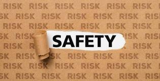 Papier déchiré - sécurité ou risque images stock