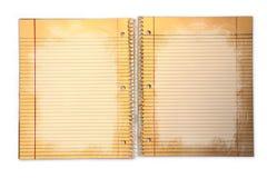 Papier d'école rayé modifié dans un cahier Photos stock