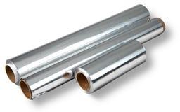 Papier d'aluminium pour faire cuire et stocker la nourriture, quatre petits pains. Images stock