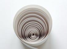 Papier dans la spirale Images stock