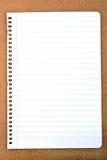 Papier dans une ligne sur un carton Photographie stock libre de droits