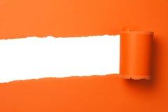 Papier déchiré orange Photographie stock