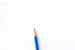 Papier de cahier avec le crayon Photographie stock libre de droits