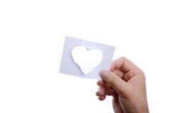 Papier de forme de coeur à disposition Image libre de droits