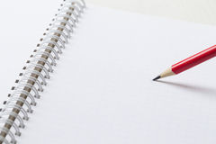 Papier de graphique avec le crayon rouge Image libre de droits