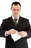 Papier de larme d'homme d'affaires Photographie stock libre de droits