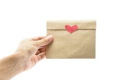 Papier de lettre de prise de main Photographie stock libre de droits
