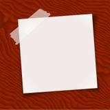 Papier de note enregistré sur bande sur le bois Photos libres de droits