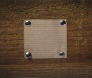 Papier de note sur des affaires en bois de mur Photo libre de droits