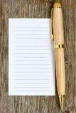 Papier de stylo et de note pour votre texte photo stock