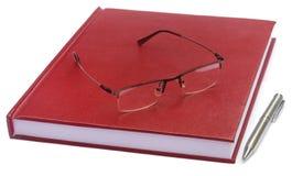 Papier de thèse coloré par rouge foncé avec des lunettes Photo stock