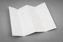Papier gefaltet mit Weltkarte Lizenzfreies Stockbild