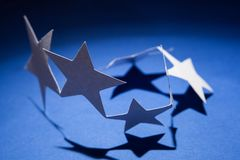 Papier gwiazd grupa na colour tle Zdjęcie Royalty Free
