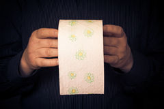 Papier hygiénique de petit pain d'homme Image stock